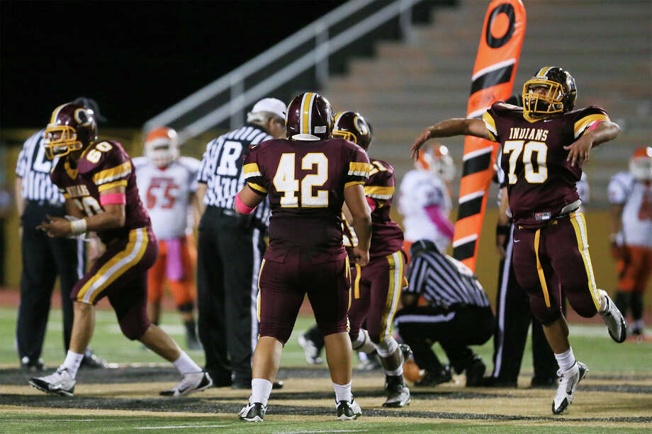 The Harlandale Indians celebrate after holding Burbank on fourth down, with 26 seconds left, to win the 2014 game. Harlandale beat The Bulldogs 28-27. MARVIN PFEIFFER/ mpfeiffer@express-news.net Photo: Marvine Pfeiffer / E-N Communities / Express-News 2014