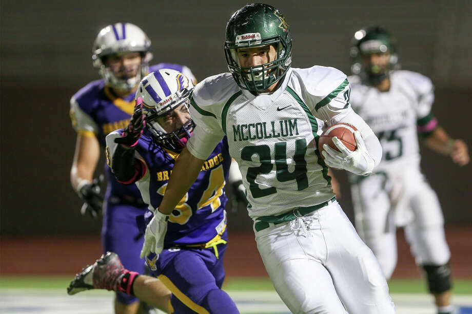 McCollum's Mike Ramirez (24) looks for running room as Brackenridge's Eddie Rodriguez tries to bring him down from behind during the first half of their game at Alamo Stadium onOct. 16, 2014. Brackenridge beat the Cowboys 44-28. Photo: Marvin Pfeiffer /San Antonio Express-News / Express-News 2014