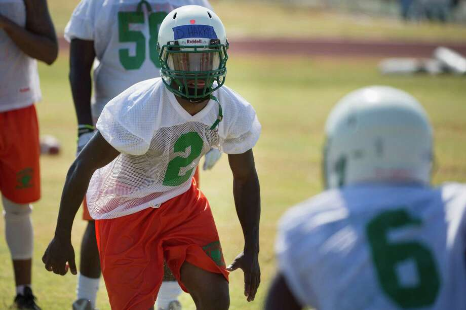 Returning running back  Devin Harris runs drills in early August. He's among the reasons the Sam Houston Hurricanes are expecting another stellar year in District 28-5A football. They went 8-3 overall and 8-0 in district play last year. Photo: Darren Abate / San Antonio Express-News / San Antonio Express-News