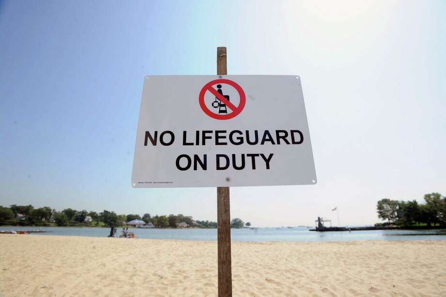 The state Department of Energy and Environmental Protection says there will be fewer lifeguards at state beaches this weekend. After Labor Day, there will be none. Photo: Bob Luckey / Bob Luckey / Greenwich Time
