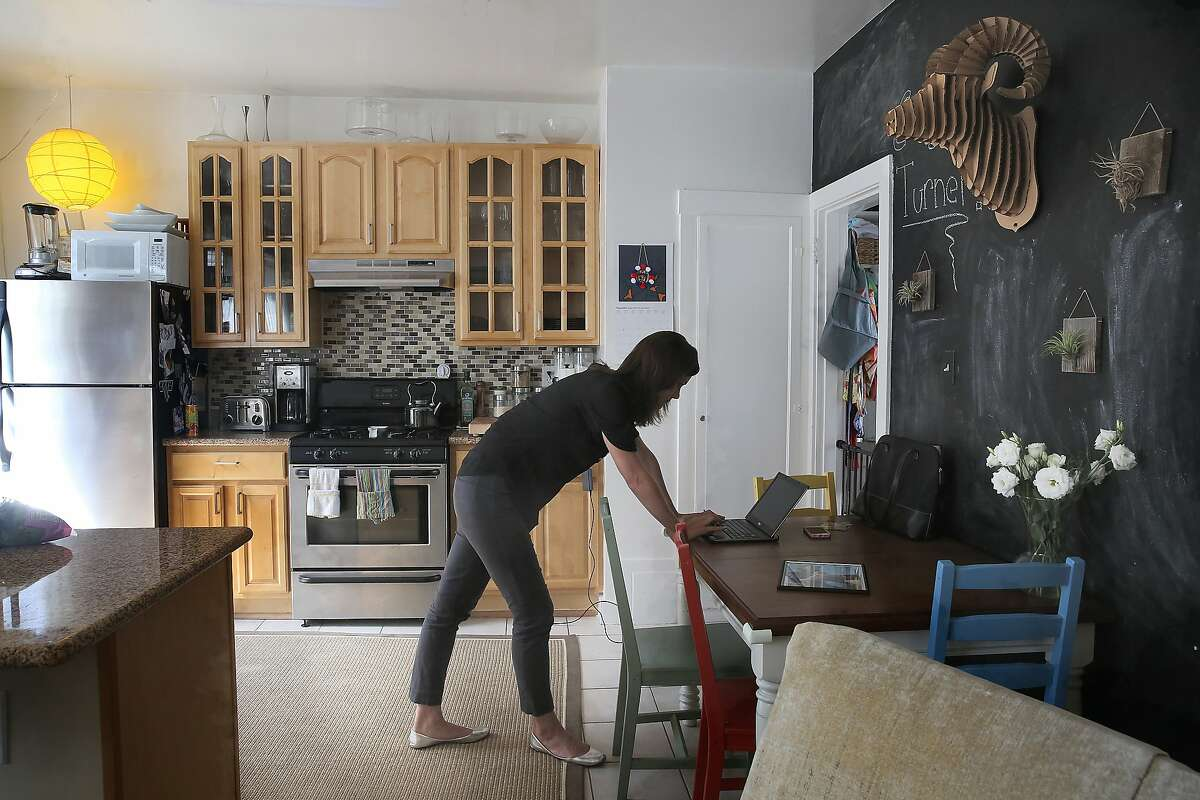 Research health science specialist Adrienne J. Heinz, Ph.D., works on a donation page for 'Out of the Darkness ' community walks of the American Foundation for Suicide Prevention on her kitchen table at home in San Francisco, Calif., on Friday, August 28, 2015. Her brother Austen Heinz, founder of the synthetic biology startup Cambrian Genomics died of depression earlier this year.