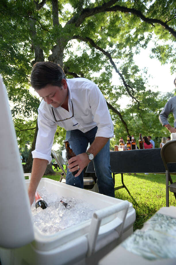 Bobby Beaver reaches into the cooler for a beer at the Beaumont Heritage Society's Heritage Happy Hour at the John Jay French Museum on Thursday. Photo taken Thursday, August 27, 2015 Guiseppe Barranco/The Enterprise Photo: Guiseppe Barranco, Photo Editor