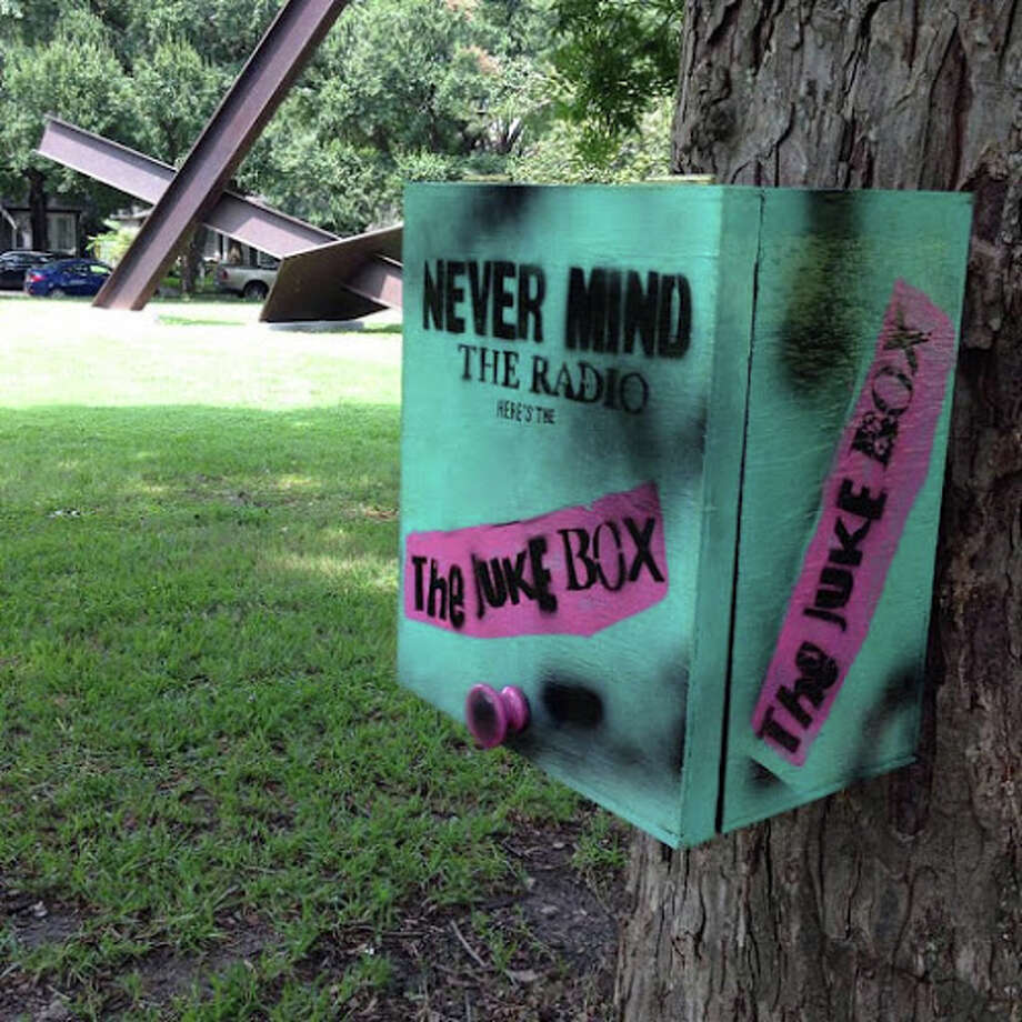 Local artist Jacob Calle's latest project is a box in Menil Park where strangers can exchange compilation mixes with each other. Affixed to a tree in the park next to the Menil Collection in Montrose is a box where strangers can exchange anything from mix discs, cassette tapes, or even jump drives to share music for others to discover. (Photo: Jacob Calle)