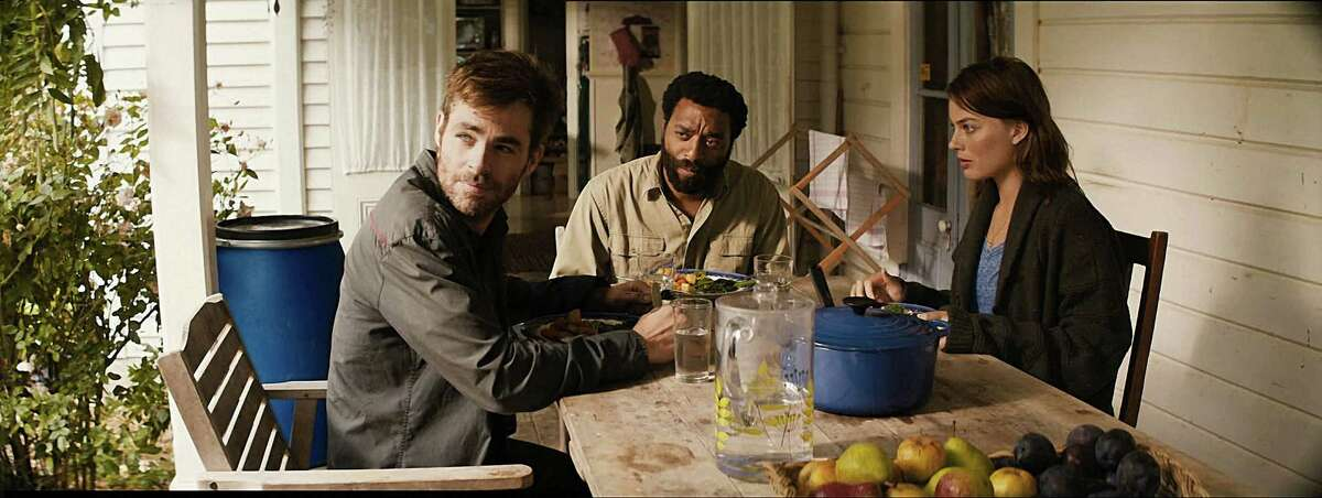 """Chris Pine, from left, Chiwetel Ejiofor and Margot Robbie star as cataclysm survivors in """"Z for Zachariah."""""""