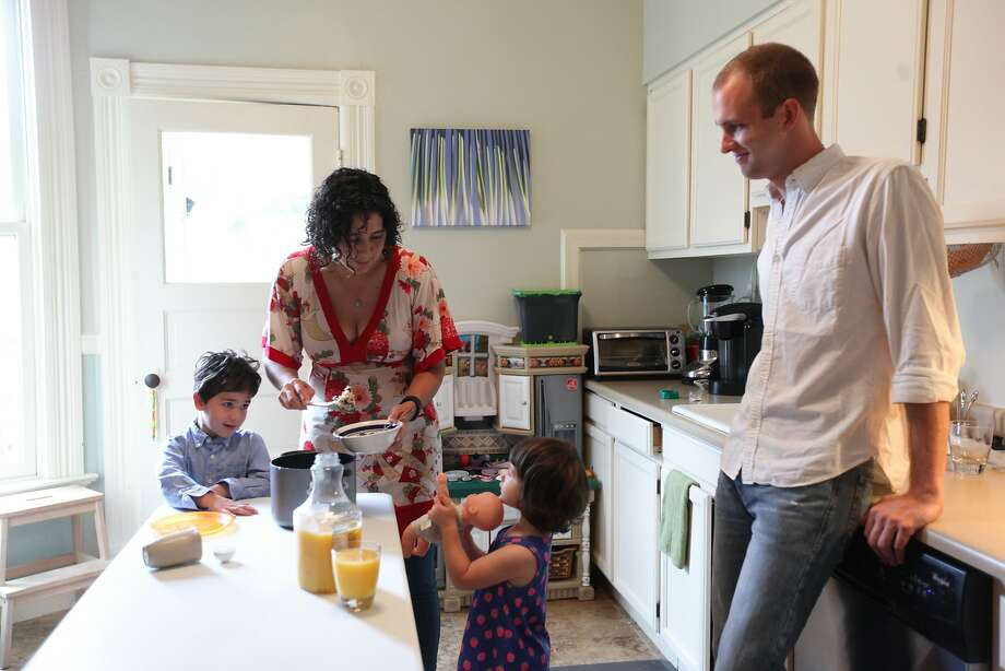 Neighbors sue neighbors over short-term rentals?Prop F on Tuesday's San Francisco ballot would make it easier for neighbors to sue other neighbors for hosting Airbnb guests. (Airbnb guest Brett Davis (right) watches while host Kim Jacoby (center) gets oatmeal prepared for her family.) Photo: Gabrielle Lurie, Special To The Chronicle