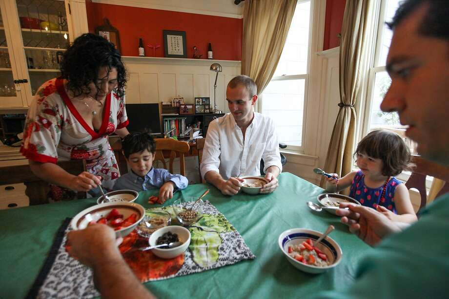 (l-r) Kim Jacoby, Max Jacoby, Brett Davis, Olivia Jacoby and David Jacoby share a morning breakfast at the Jacoby's house in San Francisco, California, on Friday, Aug. 28, 2015. Brett Davis, is a guest, who's staying in the Jacoby's Airbnb. Proposition F, the ballot initiative to rein in short-term rentals, would make it easier for neighbors to sue other neighbors, like the Jacoby's for hosting Airbnb guests. Photo: Gabrielle Lurie, Special To The Chronicle