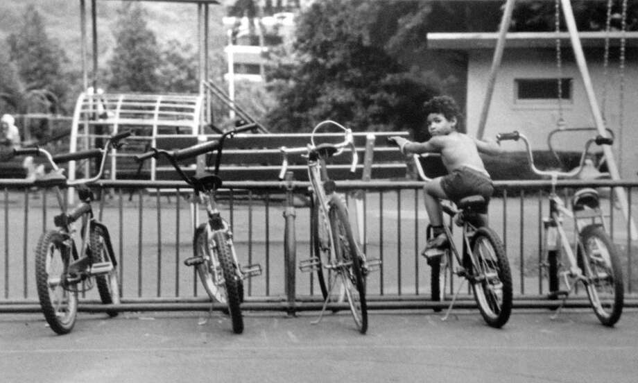 Jeff Martinez, 5, tried out a bike belonging to an older child for size at the playground in the Ed Hunt Recreation Park at Courtland Avenue and Main Street in July 1985. Photo: Tom Ryan / Hearst Connecticut Media / Stamford Advocate