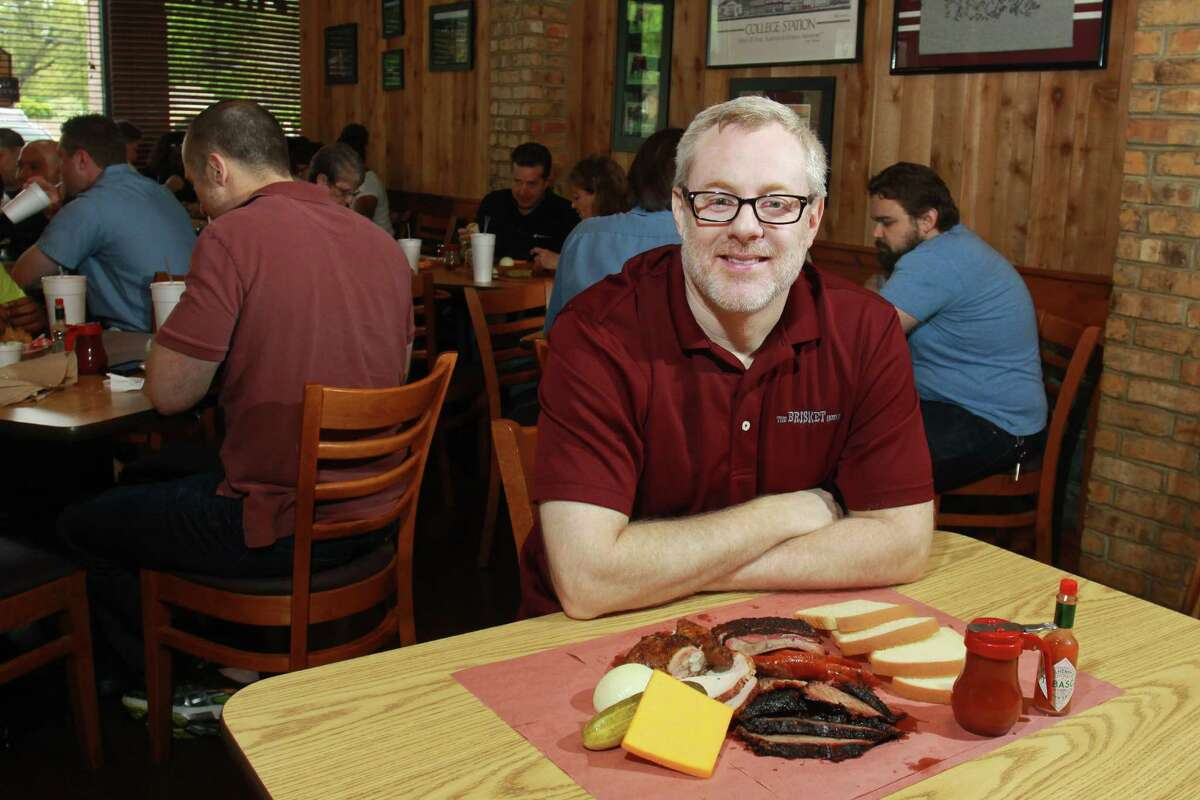 """(For the Chronicle/Gary Fountain, March 28, 2014) Wayne Kammerl, owner/pitmaster of the Brisket House in west Houston, with the """"One-pound Brisket House Special,"""" which includes brisket, jalapeno sausage, turkey breast, St. Louis ribs, chicken, cheddar cheese, pickle, onion and bread."""