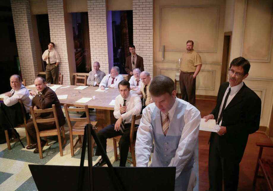 "Kevin Dean uses a diagram during a scene from ""12 Angry Men,"" performed at A. D. Players, Wednesday, Aug. 26, 2015, in Houston. ( Jon Shapley / Houston Chronicle ) Photo: Jon Shapley, Staff / © 2015 Houston Chronicle"