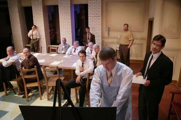 "Kevin Dean uses a diagram during a scene from ""12 Angry Men,"" performed at A. D. Players, Wednesday, Aug. 26, 2015, in Houston. ( Jon Shapley / Houston Chronicle )"