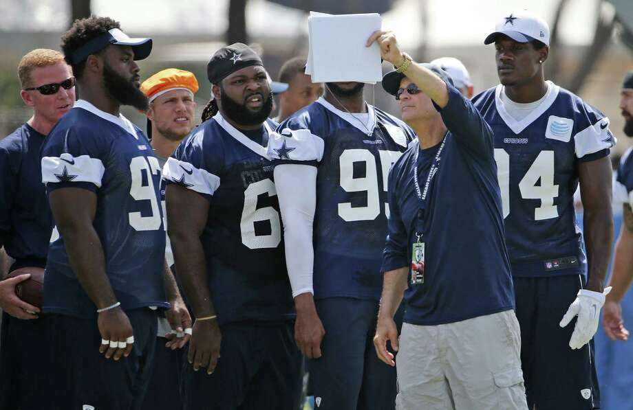 Dallas Cowboys defensive coordinator/defensive line coach Rod Marinelli holds up a play for the linemen during the morning walk through in the team's Oxnard, Calif., training camp on Friday, July 31, 2015. (Paul Moseley/Fort Worth Star-Telegram/TNS) Photo: Paul Moseley /Fort Worth Star-Telegram / Fort Worth Star-Telegram