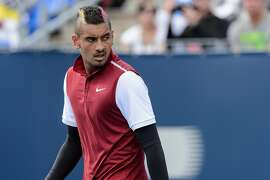MONTREAL, ON - AUGUST 13:  Nick Kyrgios of Australia looks on during his match against John Isner of the USA on day four of the Rogers Cup at Uniprix Stadium on August 13, 2015 in Montreal, Quebec, Canada.  John Isner  defeated Nick Kyrgios 7-5, 6-3.  (Photo by Minas Panagiotakis/Getty Images)