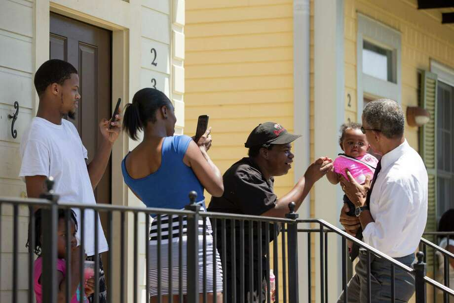 President Barack Obama greets residents in the the Tremé neighborhood in New Orleans, Thursday, Aug. 27, 2015, for the 10th anniversary since the devastation of Hurricane Katrina. Tremé is one of the oldest black neighborhoods in America, which borders the French Quarter just north of Downtown. (AP Photo/Andrew Harnik) Photo: Andrew Harnik, Associated Press / AP