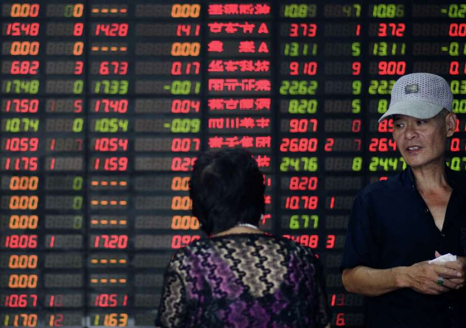 Investors stand in front of screens showing stock prices at a brokerage house in Shanghai. The 43 percent decline so far in the Shanghai Composite Index has led to a loss of $5 trillion — but that's modest compared to other market meltdowns across the globe. Photo: Johannes Eisele /AFP / Getty Images / AFP