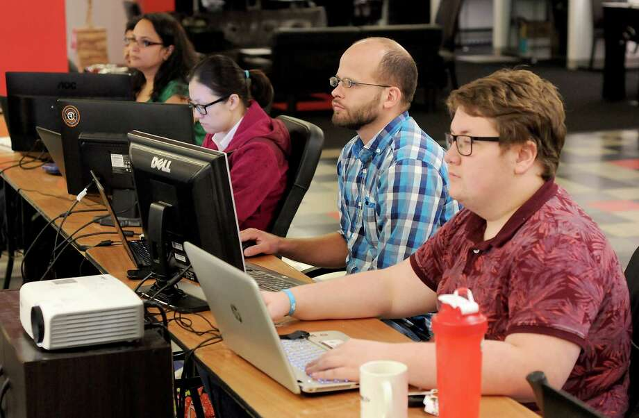 Instructor Eric Siebeneich talks about different software choices at Coder Camps in Pearland. Students there spend three weeks learning basic coding skills and nine weeks on Web design and back-end programming. Photo: Dave Rossman, Freelance / Freelalnce