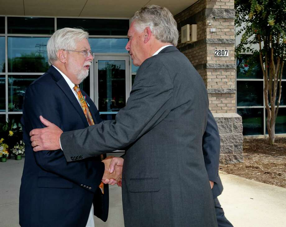 Virginia Gov. Terry McAuliffe (right) greets Jeff Marks, president and general manager of WDBJ, in Roanoke, Va.  The governor met privately Friday with grieving station employees to share his condolences. Photo: Stephanie Klein-Davis /Roanoke Times / The Roanoke Times