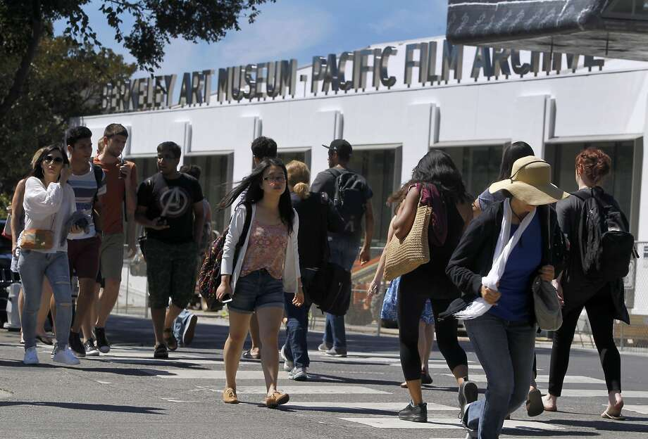 Cal students walk past the future home of the Berkeley Art Museum on Center Street in Berkeley, Calif. on Friday, Aug. 28, 2015. Several multi-level residential and commercial development projects are changing the landscape of the downtown area. Photo: Paul Chinn, The Chronicle