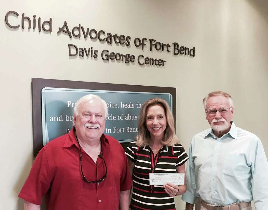 Exchange Club of Missouri City President Joel Battle, left, and representative Bob Mayo presented a check for sponsorship of the Voices for Children Breakfast to Child Advocates CEO Ruthanne Mefford.  The breakfast is set for Tuesday, Sept. 29. Photo: Child Advocates Of Fort Bend