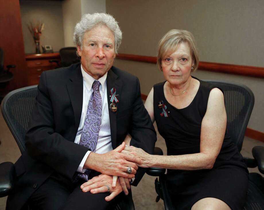 Andy and Barbara Parker, of Collinsville, Va. mourn the loss of their daughter, Alison Parker, a journalist for WDBJ, Friday, Aug. 28, 2015 in Roanoke, Va. Reporter Alison Parker and cameraman Adam Ward were killed by a former colleague during a live broadcast Wednesday, while on assignment in Moneta, Va. (Stephanie Klein-Davis/The Roanoke Times via AP) LOCAL TELEVISION OUT; SALEM TIMES REGISTER OUT; FINCASTLE HERALD OUT;  CHRISTIANBURG NEWS MESSENGER OUT; RADFORD NEWS JOURNAL OUT; ROANOKE STAR SENTINEL OUT; MANDATORY CREDIT MBI Photo: Stephanie Klein-Davis, MBI / The Roanoke Times