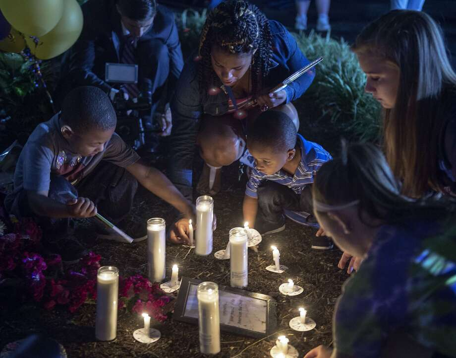 "People participate in a candlelight vigil on the front driveway of WDBJ-TV's television studios  on August 27, 2015,  in Roanoke, Virginia. The former television reporter who shot dead two journalists during a live US broadcast before killing himself warned he had been a ""human powder keg... just waiting to go BOOM."" The gunman -- Vester Lee Flanagan, 41, also known as Bryce Williams --posted chilling footage of Wednesday's shocking double murder online. Reporter Alison Parker, 24, and cameraman Adam Ward, 27, were shot and killed at close range while conducting an on-air interview at the shopping center for WDBJ, a CBS affiliate in Roanoke, Virginia, about 240 miles (385 kilometers) southwest of Washington. Friends, family and the community at large mourned the tragedy, which renewed calls for tougher gun laws in the United States. Flanagan was said to have bought his gun legally.    AFP PHOTO/PAUL J. RICHARDSPAUL J. RICHARDS/AFP/Getty Images Photo: Paul J. Richards, AFP / Getty Images"