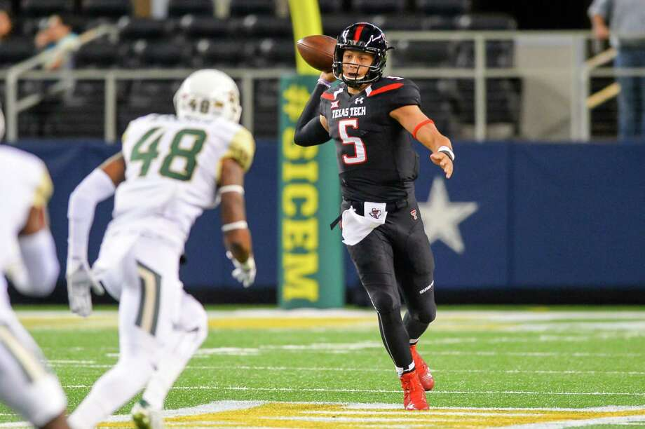 Patrick Mahomes of the Texas Tech Red Raiders looks to pass against the Baylor Bears on Nov. 29, 2014, at AT&T Stadium in Arlington. Baylor won 48-46. Photo: John Weast /Getty Images / 2014 Getty Images