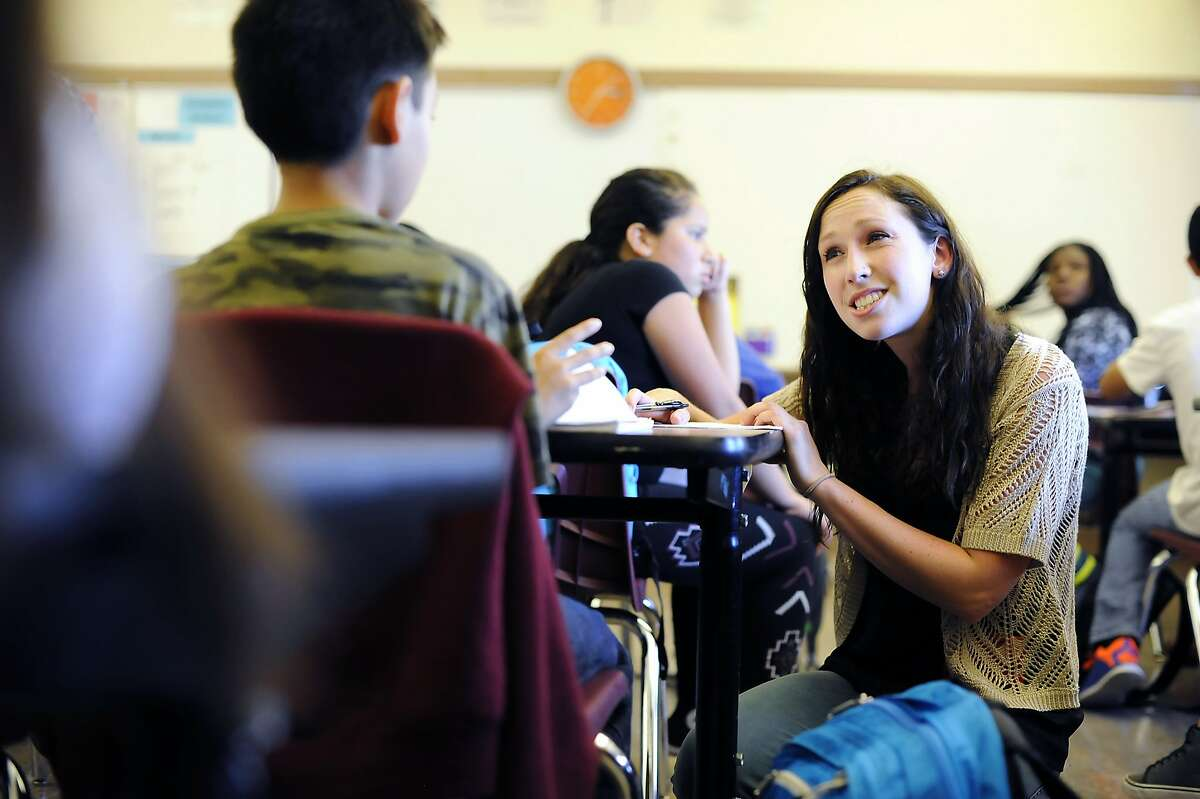 First Graduate program associate Meg Ramey meets with students during a First Graduation advisory class for 7th graders at James Denman Middle School in San Francisco, CA Friday, August 28, 2015.