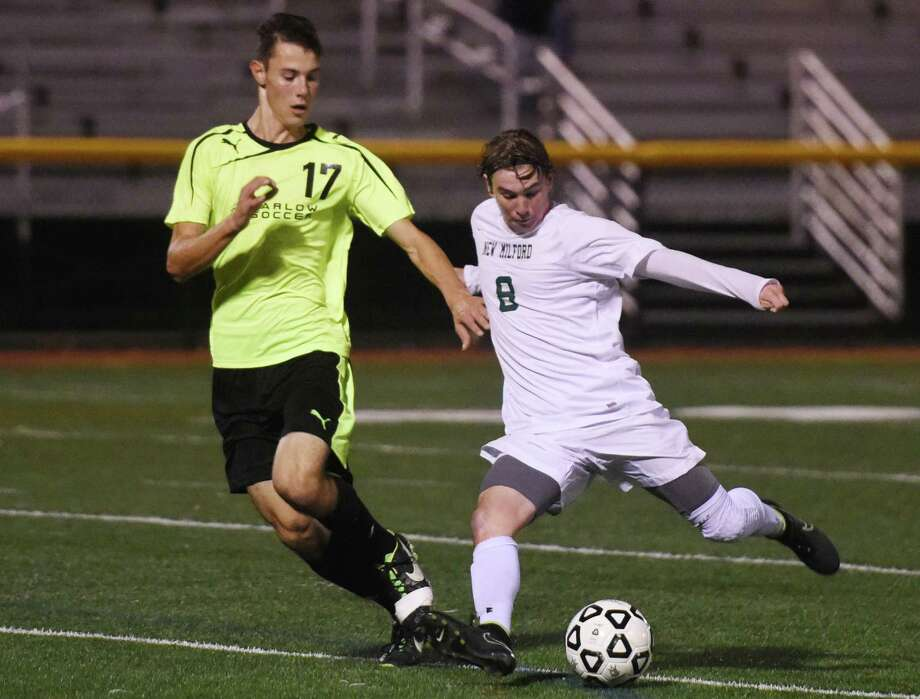 New Milford's Blaine McMahon (8) shoots past Joel Barlow defender Ryan Corr (17) in Joel Barlow's 4-0 win over New Milford in the SWC high school boys soccer semifinal game at Penders Field in Stratford, Conn. Tuesday, Oct. 28, 2014. Photo: Tyler Sizemore / Tyler Sizemore / The News-Times