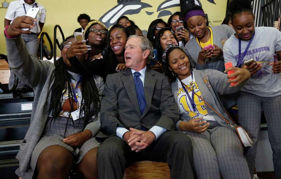Former President George W. Bush joined students at Warren Easton Charter High School in New Orleans on Friday during his tour of the Katrina-struck region. Photo: Gerald Herbert, STF / AP