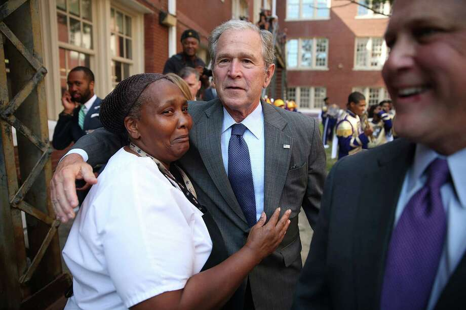 Former President George W. Bush greets people during a visit to the Warren Easton High School to mark the 10th anniversary of Hurricane Katrina on August 28, 2015 in New Orleans, Louisiana. The former President's visit came as the town prepares to honor the10th anniversary of Hurricane Katrina, which killed at least 1836 and is considered the costliest natural disaster in U.S. history, on August 29.  (Photo by Joe Raedle/Getty Images) Photo: Joe Raedle, Staff / 2015 Getty Images