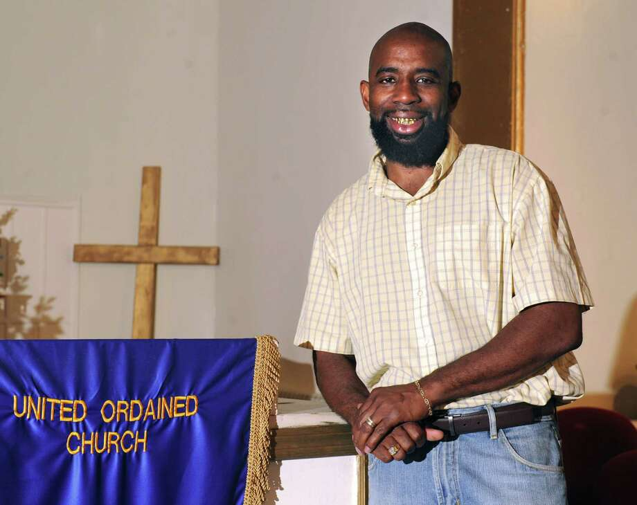 Jerry Ford, a deacon at the church, stands on the alter at United Ordained Church on Thursday, Aug. 27, 2015 in Troy, N.Y. Ford is spearheading a back-to-school/anti-violence event in Troy. (Lori Van Buren / Times Union) Photo: Lori Van Buren / 00033133A