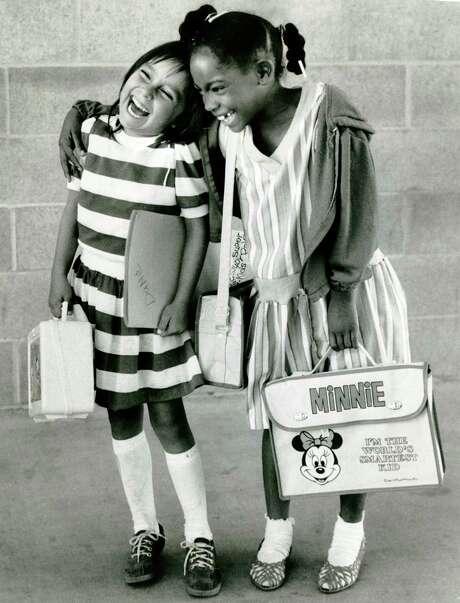 First-graders Dana Aisetewa and Tamara Richard enjoy their first day of school in San Francisco in September 1984. Photo: John O'Hara / John O'Hara / The Chronicle 1984 / ONLINE_YES