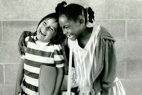 First-graders Dana Aisetewa and Tamara Richard enjoy their first day of school in San Francisco in September 1984.