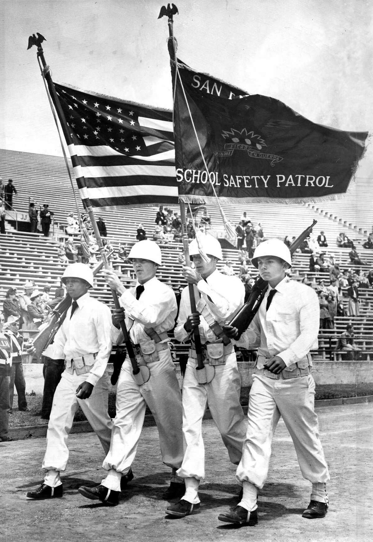 The color guard in Everett Middle School's safety patrol parade in May 1960: Ernie Escort (left), Larry Greer, Don Daniels and Don Arrighi.