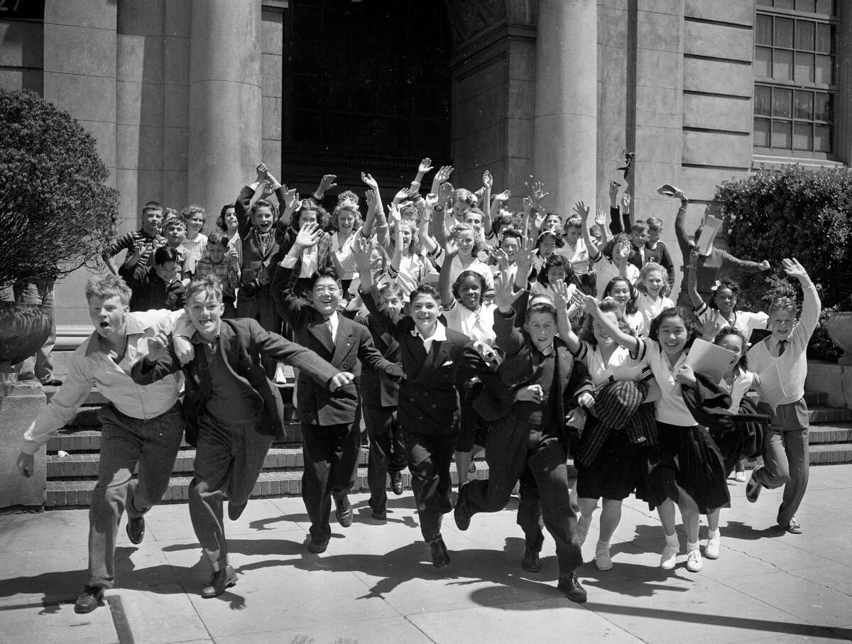 Students leave for summer vacation on the last day of class in 1940.