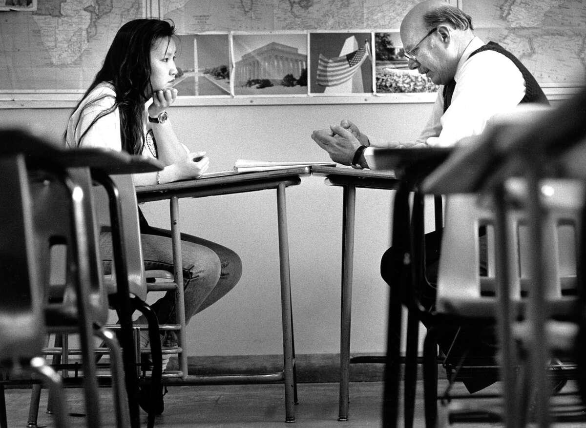Lowell High School student Ming Lee listens to history teacher Richard Soward discuss teacher layoffs in March 1991.