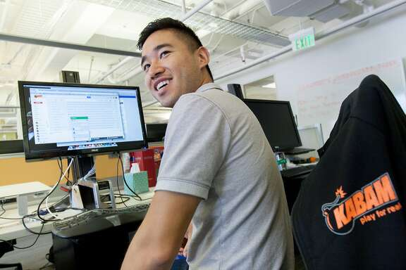 Jason Zhu, Kabam's head of UA partnerships, works at his desk, Friday, Aug. 28, 2015, in San Francisco, Calif.