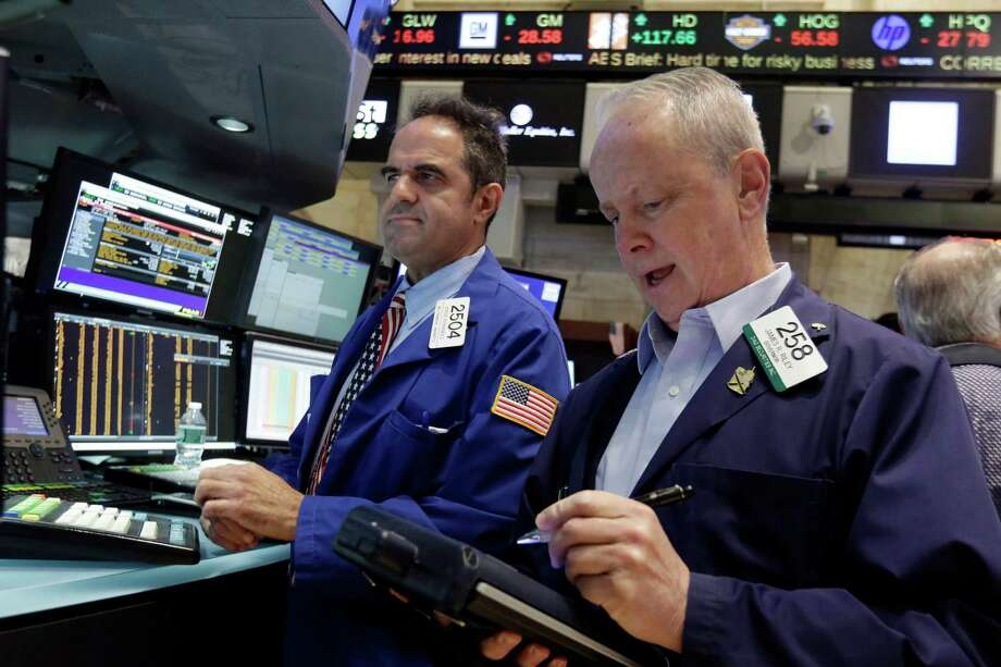 Specialist Jorge Fernandez, left, and trader James Riley work on the floor of the New York Stock Exchange, Friday, Aug. 28, 2015. U.S. stocks are opening slightly lower after a sharp two-day surge, as the stock market closes out a wild week. (AP Photo/Richard Drew) ORG XMIT: NYRD109 Photo: Richard Drew / AP