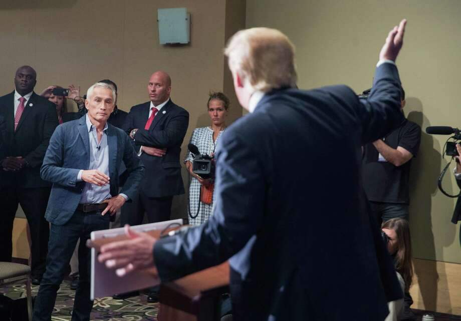 Republican presidential candidate Donald Trump fields a question from Univision and Fusion anchor Jorge Ramos during a press conference held before his campaign event at the Grand River Center on August 25, 2015 in Dubuque, Iowa. Earlier in the press conference Trump had Ramos removed from the room when he failed to yield when Trump wanted to take a question from a different reporter. Trump leads most polls in the race for the Republican presidential nomination.  (Photo by Scott Olson/Getty Images) Photo: Scott Olson, Staff / 2015 Getty Images