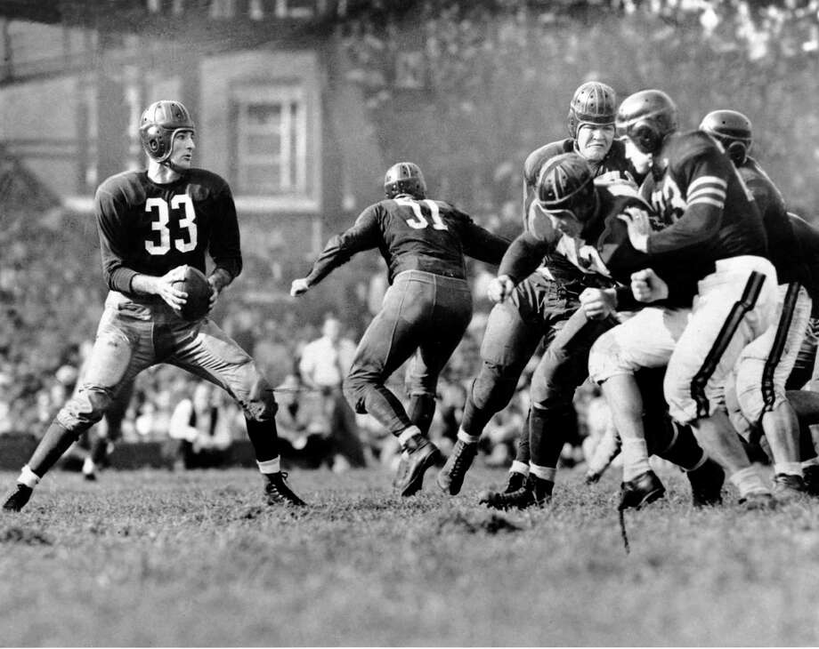 In this 1942 photo, Washington Redskins quarterback Slingin' Sammy Baugh, drops back to pass against the Chicago Bears. Baugh, who set numerous passing records with the Redskins, died in Rotan, Texas, in 2008 at 94. / AP