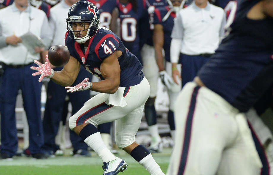Houston Texans' Jonathan Grimes (41) makes a catch against the Denver Broncos during the first half on Aug. 22, 2015, in Houston. Grimes got an NFL pink slip four times before finally hanging on with the Texans and spending all of last season with the team. With his football future in doubt so many times the running back leaned heavily on his other love: music. Photo: George Bridges /Associated Press / FR171217 AP