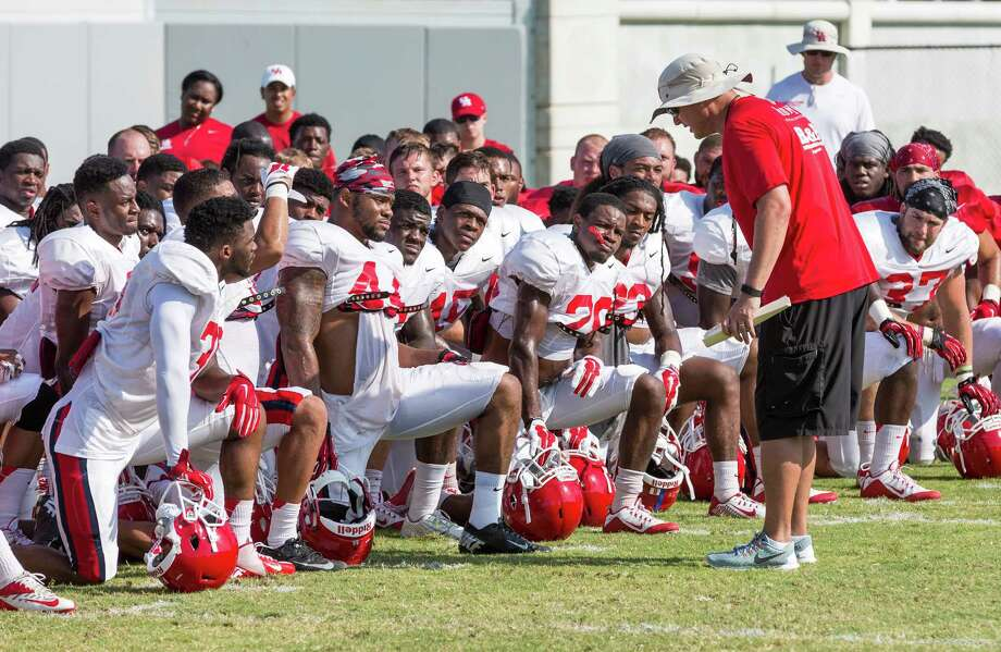 UH football practice. UH practice field behind Alumni Athletic Office, UH campus. ID: Head coach Tom Herman talks to the defensive line before today's practice. Tuesday  August 11, 2015  (Craig H. Hartley/For the Chronicle) Photo: Craig Hartley, Freelance / Copyright: Craig H. Hartley