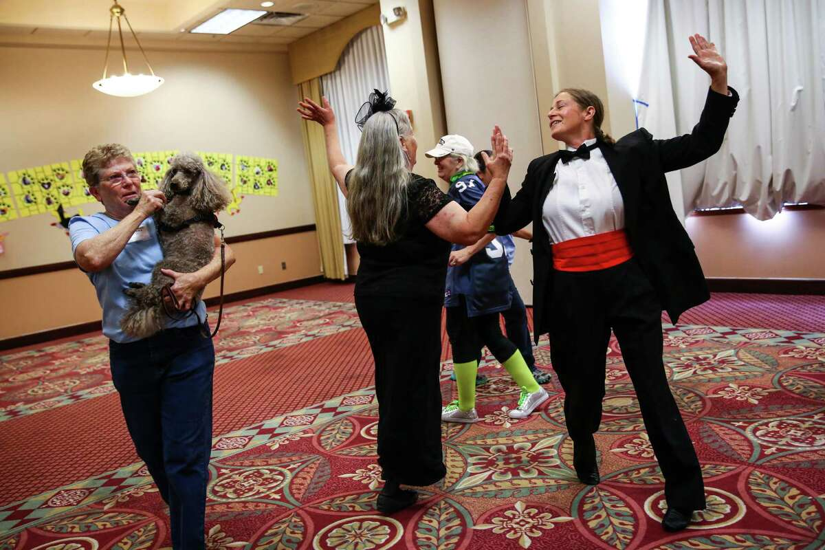 Participants do a group dance during the World Canine Freestyle Organization conference. Dog owners competed with their pups for honors as they danced, twirled and performed freestyle dance routines. Photographed on Friday, August. 28, 2015, at the Best Western hotel in Federal Way.