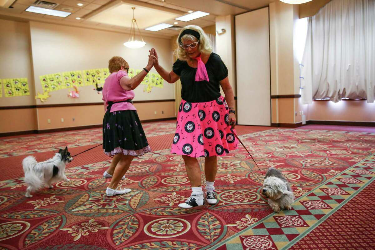 Jane Douglas and her dog Juno performs with Heather VanOene and her dog Gracie during the World Canine Freestyle Organization conference. Dog owners competed with their pups for honors as they danced, twirled and performed freestyle dance routines.