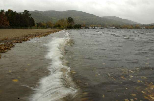 Times Union staff photo by Paul Buckowski ---  A view of Lake George from Million Dollar Beach in Lake George, N.Y. on Tuesday, Oct. 25, 2005.  In the background Prospect Mountain is seen rising above the village.  Part of  the West Brook Watershed Protection Project is a plan to secure 1,400 acres on the hillside at the headwaters of the stream to protect that source area.  West Brook empties into the lake. Photo: Paul Buckowski / Albany Times Union