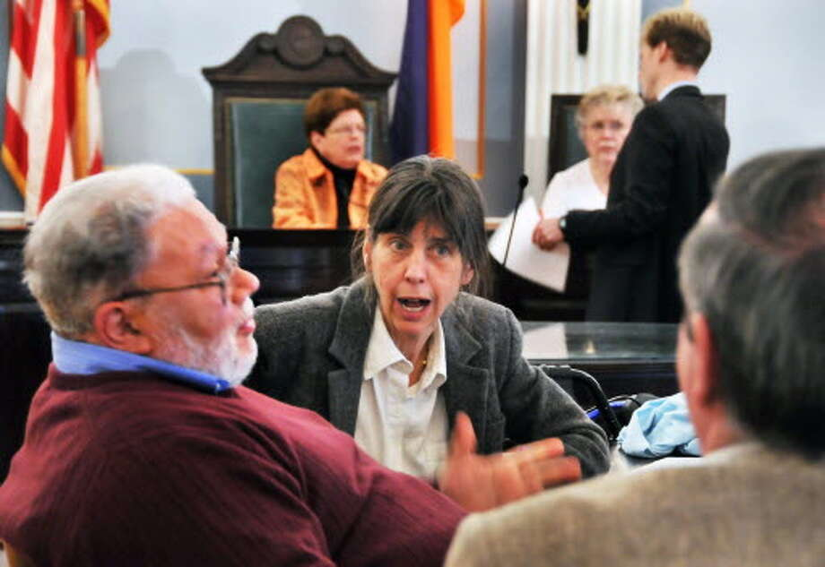 Schenectady City Council members Tom Della Sala, left, Barbara Blanchard, and Gary McCarthy (at right)brings discuss details of new Schenectady City budget prior to its passing at a council meeting in City Hall Friday afternoon October 30, 2009. (John Carl D'Annibale / Times Union)