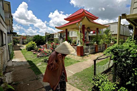 A Buddhist shrine stands out in the north courtyard at Thai Xuan Village on Broadway Street Houston. A Catholic priest and Vietnamese refugee  with community support purchased this complex in the 1980s, creating the Vietnamese village.