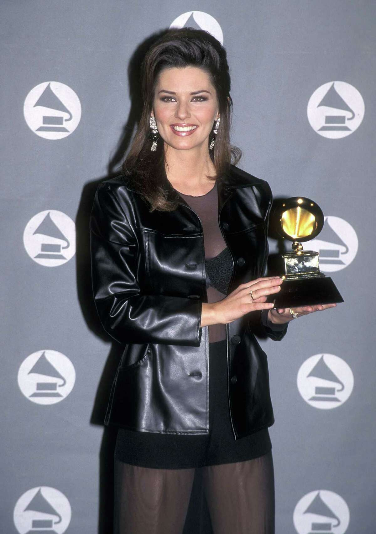 Shania Twain shows off her Grammy Award on Feb. 28, 1996 in Los Angeles.