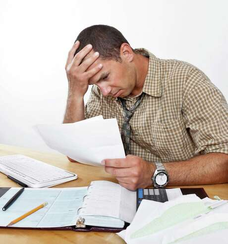 A new study suggests that paying off your debts smallest to largest might be the best method to tackling your debt. Photo: Fotolia /TNS / Fotolia