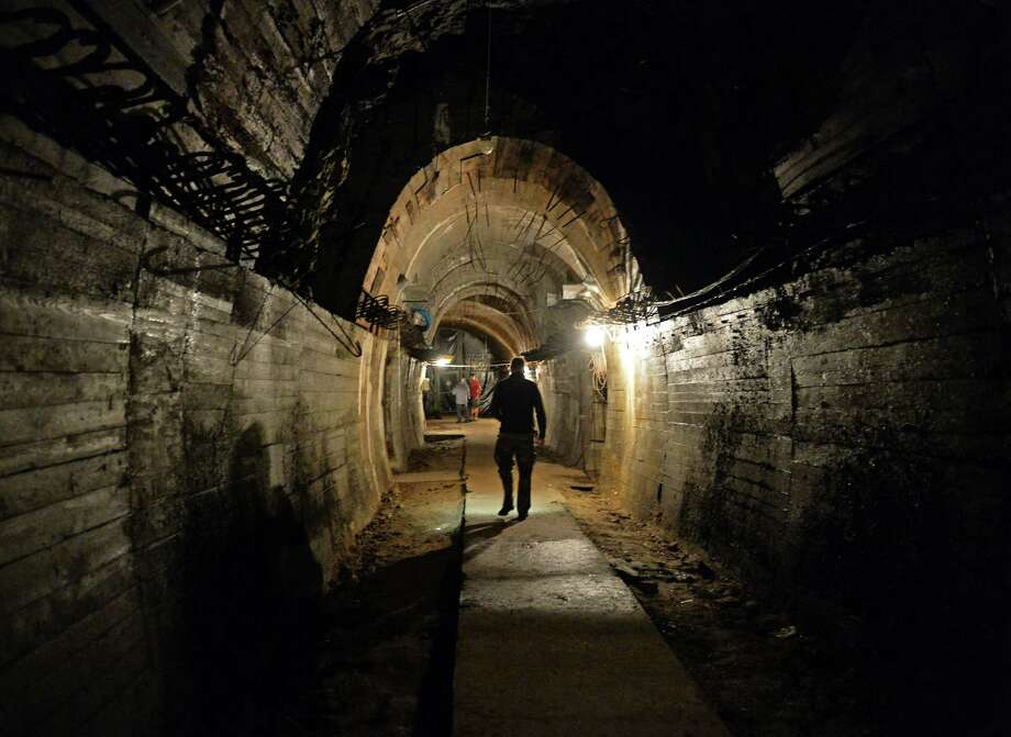 "Man walk in an underground tunnel under the Ksiaz castle in Walbrzych, Poland, where the Nazi ""gold train"" supposedly is hidden. Photo: Janek Skarzynski /Getty Images / JANEK SKARZYNSKI"