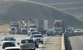 Big rig trucks use three of four lanes of eastbound I-580 out of Livermore Valley. Loaded trucks crawl along this section of I-580 heading up to the Altamont Pass at an elevation 1,009 feet. The California Transportation Commission decides today how to disperse $2 billion to $3 billion in transportation bonds. This money is devoted to easing traffic congestion by speeding truck travel with climbing lanes and more rail access. And despite a Southern California effort to snag all the money, Northern California looks to get a big share, which could go for truck climbing lanes over the Altamount and Donner Summit and for rail improvement near the port of Oakland. Photo taken on 11/27/07, in Livermore, CA. Photo by Michael Maloney / San Francisco Chronicle  Ran on: 11-28-2007 Big-rig trucks use three of four lanes crawling up Interstate 580 out of Livermore Valley; there are no climbing lanes on the grade heading up to Altamont Pass. Ran on: 11-28-2007 Big-rig trucks use three of four lanes crawling up Interstate 580 out of Livermore Valley; there are no climbing lanes on the grade. Ran on: 11-28-2007